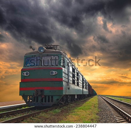 Cargo trains with a sunset sky background - stock photo