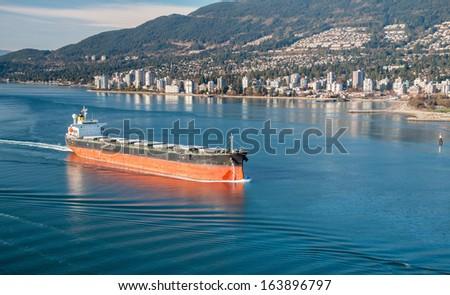 Cargo vessel heading to Vancouver harbour - stock photo