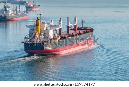 Cargo vessel heading to Vancouver harbour - stock photo