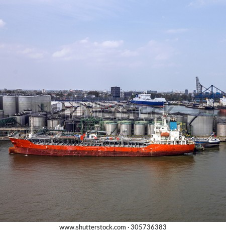 Cargo vessel in sea port Rotterdam, Netherlands. - stock photo