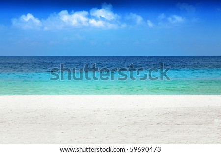 Caribbean beach featuring levels of white sand, emerald water, dark blue water, and blue sky with clouds - stock photo