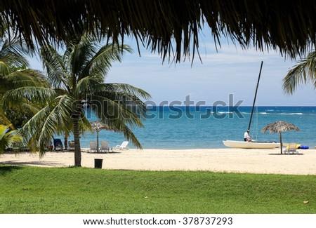 Caribbean beach. Typical tropical vacation. Cuba - stock photo