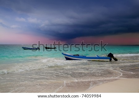 Caribbean before tropical storm hurricane beach boat dramatic scenic - stock photo