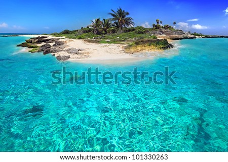 Caribbean island with perfect lagoon - stock photo