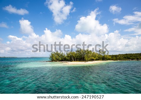 Caribbean island with perfect turquoise water. - stock photo