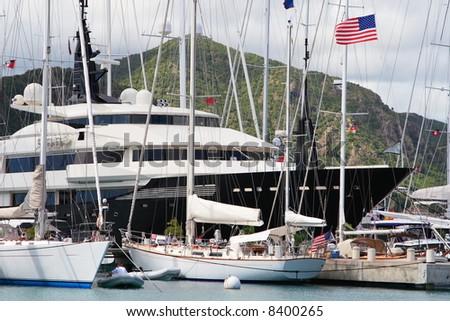 Caribbean Mega Yachts docked on the island of Antigua - stock photo