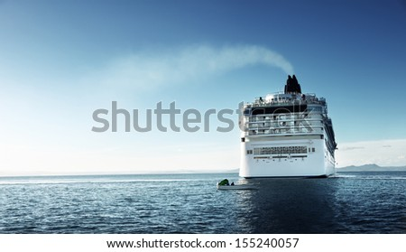 Caribbean sea and cruise ship in sunset time - stock photo