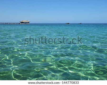 Caribbean sea with cloudless sky - stock photo
