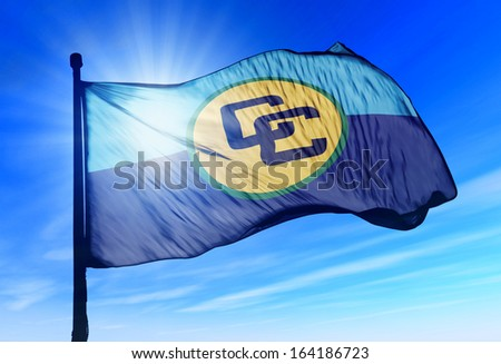 CARICOM flag waving on the wind - stock photo