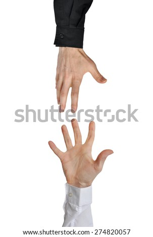 Caring hand reaching to help another in need - stock photo