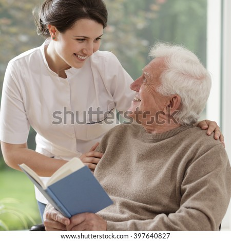 Caring nurse talking with patient - stock photo