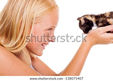 caring teen girl holding a little kitten isolated on white - stock photo
