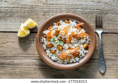 Carnaroli rice with seafood - stock photo