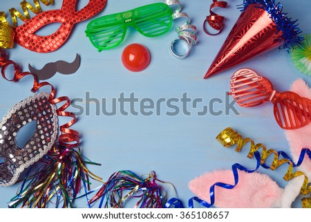 Carnival  background with mask, costume and glasses. View from above - stock photo