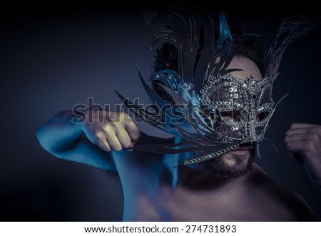 Carnival, bearded man with silver mask Venetian style. Mystery and renaissance - stock photo