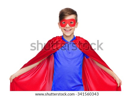 carnival, childhood, power, gesture and people concept - happy boy in red super hero cape and mask - stock photo
