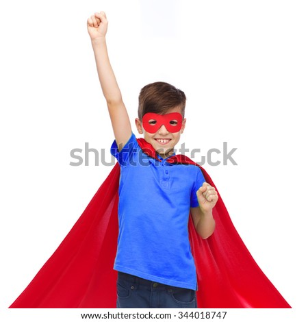 carnival, childhood, power, gesture and people concept - happy boy in red super hero cape and mask showing fists - stock photo