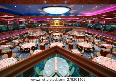 "CARNIVAL ""CONQUEST"" - 4 AM. JUNE 5, 2008: Renoir Forward Restaurant. Cruise ship main dining room for over 1,000 seats is awaiting for new guests. - stock photo"