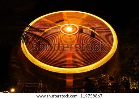 Carnival ferris wheel ride at a fun fare - stock photo
