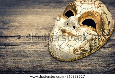 Carnival mask harlequin. Mardi gras. Holidays background. Vintage toned - stock photo