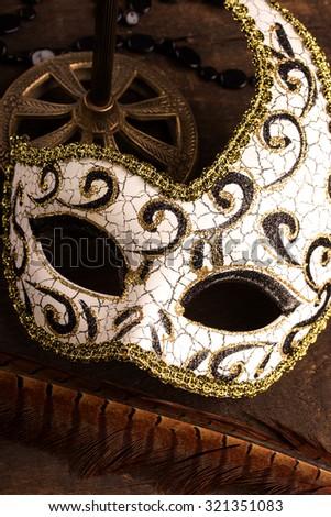 carnival mask on dark wooden background - stock photo