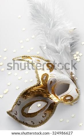 Carnival mask on light grey background - stock photo