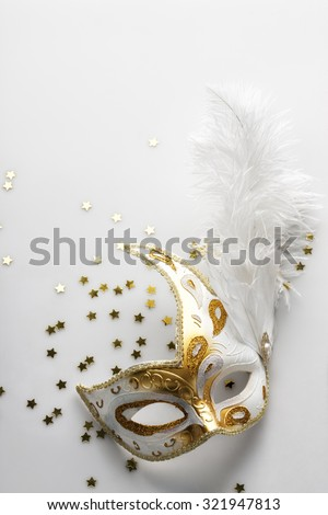 Carnival mask on light grey background. Background for party invitation card. Space for text. - stock photo