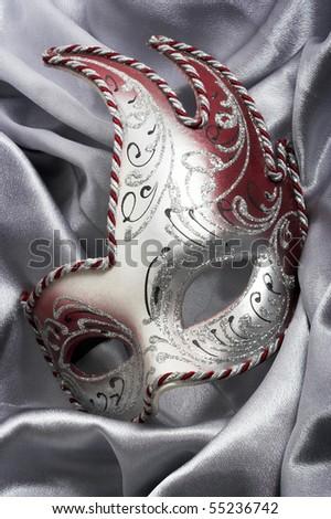 Carnival mask over gray satin - stock photo