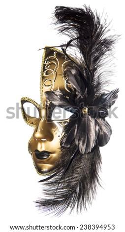 Carnival masquerade mask  black gold lush feathers on side white background  New year Christmas - stock photo
