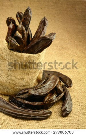 Carobs in Bag - stock photo