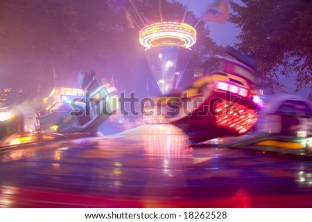 Carousel at amusement park - stock photo