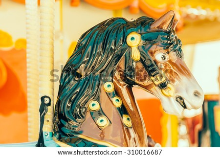 Carousel horse in the park - vintage filter effect - stock photo