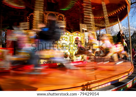 Carousel merry-go-round while rounding - stock photo