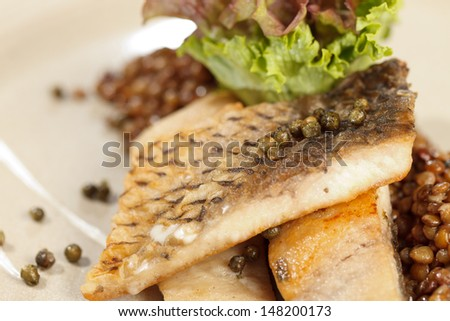 carp with green lentil - stock photo