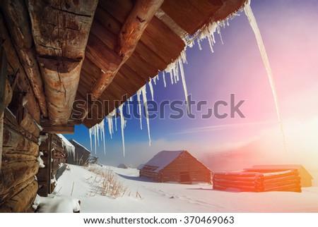 Carpathian mountain village covered with fresh snow. Sunny winter day. Ukraine, Europe - stock photo