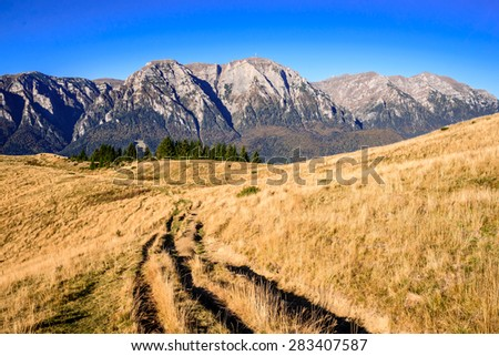 Carpathian Mountains. Bucegi rocky ridge in autumn colors, amazing alpine landscape in Busteni, Prahova Valley. - stock photo