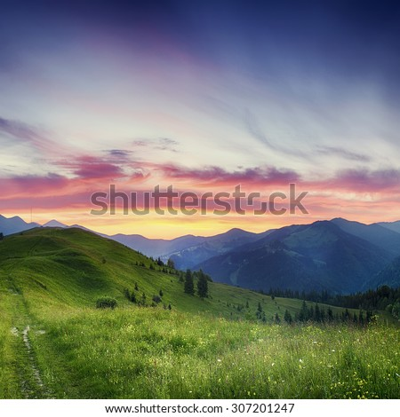 Carpathian mountains summer  sunset landscape with  dramatic sky and blue mountains - stock photo