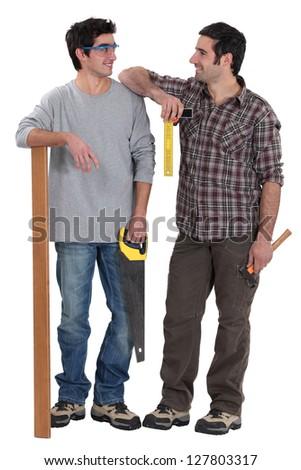 Carpenter and his apprentice - stock photo