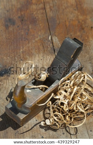 carpenter hand plane on wooden background.copy space - stock photo
