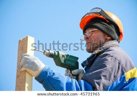 Carpenter makes a wooden hothouse - stock photo