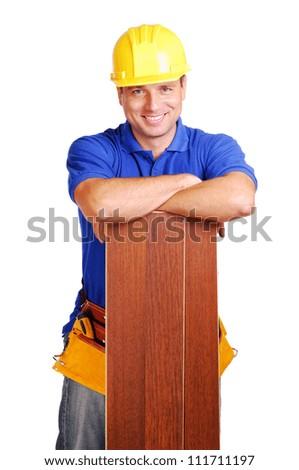 Carpenter on white background holding the floor board - stock photo