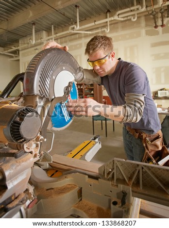 Carpenter or construction worker man with power tool - stock photo