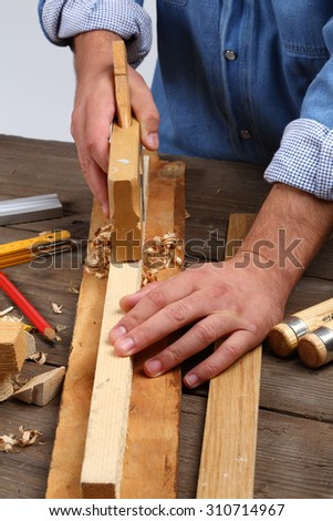 carpenter's hands - working with plane - stock photo