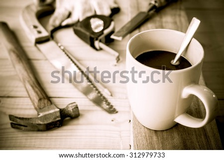 carpenter tools,hammer,meter,pencil,shavings, and chisel over wood table - stock photo