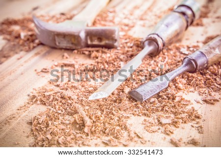carpenter tools in pine wood table - stock photo