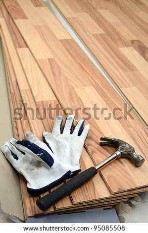 Carpenter tools on new panels floor - stock photo