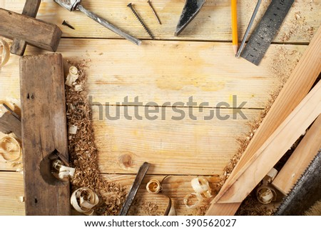 carpenter tools on wood table background - stock photo