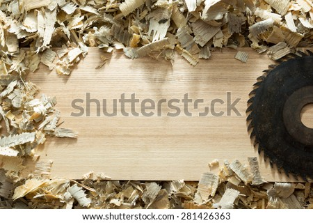 Carpenter tools on wooden table with sawdust. Carpenter workplace top view  - stock photo