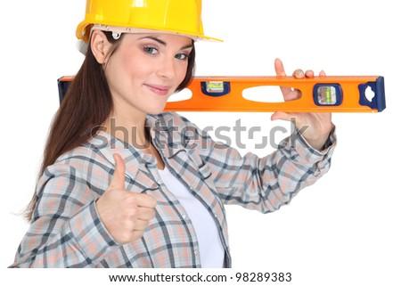 carpenter with spirit level - stock photo