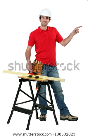 Carpenter with work-bench - stock photo